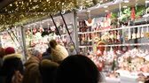 hóember : Strasbourg, France - Circa 2018: Tilt-shift lens over Strasbourg annual Christmas winter market tourists and locals shopping for handmade toys at market stall Stock mozgókép