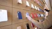 электроника : Paris, France - Circa 2019: Apple iPhone XS protection cases products are displayed inside the new Apple Store Champs-Elysees largest French store located in the heart of the capital people testing