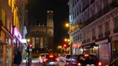 aziz : Paris, France - Circa 2019: Saint-Vincent de Paul Catholic Church in central Paris 9th arrondissement with perspective view from  Rue dHauteville street with hotels, shops and restaurants at night Stok Video
