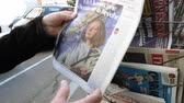 el : Paris, France - 29 Mar 2019: Newspaper stand kiosk selling press with senior male hand buying latest La Croix featuring news about Presidential Elections in Ukraine on front cover
