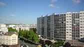 trein : Paris, France - Circa 2019: View from the flying drone of Parisian cityscape aerial with apartments buildings, warehouses, supermarkets and clear blue sky Stockvideo