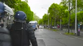 bala : Strasbourg, France - Apr 28, 2019: French Police gendarmes officers securing street Alee de la Robertsau near Council of Europe street after altercations with Yellow Vests Archivo de Video