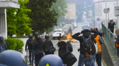 overheid : Strasbourg, France - Apr 28, 2019: French journalists reporting as gendarmes police officers intervention with tear gas on rue Daniel Hirtz street during altercations yellow vests waste bin fire