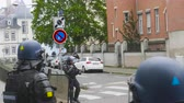 overheid : Strasbourg, France - Apr 28, 2019: French gendarmes police officers intervention with tear gas on rue Daniel Hirtz street during altercations yellow vests waste bin fire