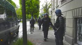 strike : Strasbourg, France - Apr 28, 2019: French Police officer securing zone during Yellow Vest on Rue Rene Schickele street after altercations Stock Footage