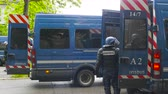 bala : Strasbourg, France - Apr 28, 2019: French Police officers gendarmes loading in van boxes with 1330-14-548-9477 hand launcher grenades supply for next altercations Yellow vests protestors