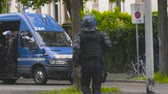 протест : Strasbourg, France - Apr 28, 2019: French Police gendarmes officers running to van on  Alee de la Robertsau near Council of Europe street after altercations with Yellow Vests
