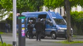 overheid : Strasbourg, France - Apr 28, 2019: French Police gendarmes officers running to van on  Alee de la Robertsau near Council of Europe street after altercations with Yellow Vests