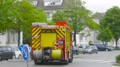 bombeiro : Strasbourg, France - Apr 28, 2019: French Scania Firefighter with blue beacon lights turned on driving fast on the street for intervention