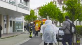 bombeiro : Strasbourg, France - Apr 28, 2019: Firefighters sapeurs pompiers talking helping woman to get object fall under a luxury Jaguar car
