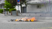 протест : Strasbourg, France - Apr 28, 2019: Waste garbage bin on fire left by Yellow vests gilets jaunes after demonstration on Rue de la Schiffmatt near European Institutions