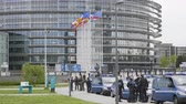 overheid : Strasbourg, France - Apr 28, 2019: Slow motion European Parliament headquarter being secured by police gendarmerie officers at entrance during Yellow Vests movement on Saturday
