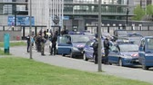 overheid : Strasbourg, France - Apr 28, 2019: Multiple police gendarmerie officers and gendarmes securing European Parliament entrance in Strasbourg during Yellow Vests movement on Saturday Stockvideo