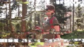 ciclista : Digital glitch effect over single young woman using smartphone walking sightseeing discovering the Vosges forest on a spring day with clear blue sky a and tall pines Vídeos