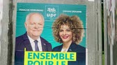 mei : Strasbourg, France - May 23, 2019: Tilt-up to posters in green sunny park for 2019 European Parliament election featuring French UPR for Frexit francois Asselineau Zamane Ziouane