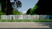 mei : Strasbourg, France - May 23, 2019: Posters in green sunny park for 2019 European Parliament election featuring French politicians and male runner looking at candidates