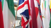 hungria bandera : Tilt up pto all United Kingdom and all European Union members flag in the media room pole of European Parliament headquarter in Strasbourg, France
