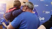указатель : Strasbourg, France - Circa 2018: European Peoples Party exhibition stand lucky wheel roulette with father and son spinning and winning prize - European Parliament interior during open day