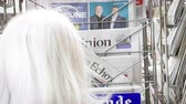 точка зрения : Strasbourg, France - May 25, 2019: Woman buying at press kiosk Les Echos newspaper featuring 2019 European Parliament election predictions a day before the vote