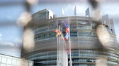 kurum : View through security fence of European Parliament headquarter in Strasbourg with all European Union Flags waving in the wind in the Sunday of 2019 European Parliament election slow motion