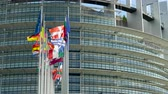 kurum : European Parliament headquarter in Strasbourg with all European Union Flags waving in calm wind in the Sunday of 2019 European Parliament election - sunny clear day