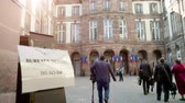 polling place : Strasbourg, France - May 27, 2019: Media journalists walking to French polling station Bureau de vote sign on door 26 May, Sunday of 2019 European Parliament election - courtyard of Hotel de Ville City hall
