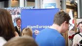 megafon : Strasbourg, France - Circa 2018: I am European and I am proud people taking photos at stand with message and next to Guy Verhofstadt real size print
