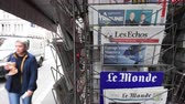 candidate : Strasbourg, France - May 27, 2019: City scene with newspaper stand featuring breaking news Les Echos newspaper front page with tile Macron limits the damage -  street press kiosk newsstand with the results of 2019 European Parliament election