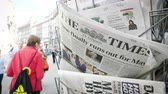 buy press : Strasbourg, France - May 24, 2019: Time finally runs out for Theresa May title on The Times newspaper with pedestrians people walking on French street - Brexit news