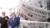 autor : Strasbourg, France - May 24, 2019: Time finally runs out for Theresa May title on The Times newspaper with pedestrians people walking on French street - Brexit news slow motion sunlight flare