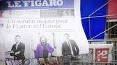 autor : Strasbourg, France - May 25, 2019: Man hand POV reading at press kiosk Le Figaro newspaper featuring 2019 European Parliament election predictions a day before the vote pictures of Jordan Bardella,  Nathalie Loiseau,Francois-Xavier Bellamy
