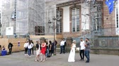 oslava : Strasbourg, France - Jun 8, 2019: Happy bride and groom with their guests waiting outside the city hall municipality building for the civil ceremony to begin - bride dancing