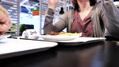 köfte : Paris, France - Circa 2019: Woman and man inside IKEA food restaurant eating French fries and Swedish meatballs drinking Pepsi sweet drink - woman reading components ingredients calories on the bottle Stok Video