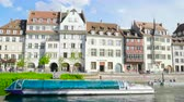 motion timelapse : Strasbourg, France - Circa 2019: Time lapse fast motion of Strasbourg famous promenade pedestrian street Quai des Bateliers with half timbered houses and people having fun admiring Batorama tourist boat