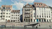 motion timelapse : Strasbourg, France - Circa 2019: Time lapse fast motion Strasbourg famous promenade pedestrian street Quai des Bateliers with half timbered houses and Ill river border on a warm spring day Stock Footage