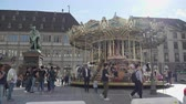 pony : Strasbourg, France - Circa 2019: People kids adults having fun taking photos at the merry go round in central Strasbourg Place Gutenberg