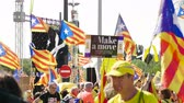 separatist : Strasbourg, France - Jul 2 2019: Large group of people holding Estelada Catalan separatist flags demonstrate protest front of EU European Parliament against exclusion of three Catalan elected MEPs Stock Footage