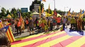 separatist : Strasbourg, France - Jul 2 2019: People near huge Estelada Catalan separatist flag on asphalt demonstration protest front of EU European Parliament against exclusion of three Catalan elected MEPs Stock Footage