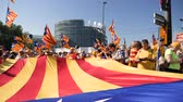 separatist : Strasbourg, France - Jul 2 2019: Slow motion people holding immense Estelada Catalan separatist flags demonstration protest front of EU European Parliament against exclusion of Catalan elected MEPs Stock Footage