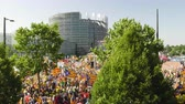 comisiÓn : Strasbourg, France - Jul 2 2019: Aerial view over thousands of people demonstrating at protest front of EU European Parliament against exclusion of three Catalan elected MEPs - drone view Archivo de Video