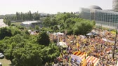 catalão : Strasbourg, France - Jul 2 2019: Drone view aerial of thousands people with Estelada separatist flags demonstrate protest at EU European Parliament against exclusion of Catalan elected MEPs