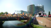 political rally : Strasbourg, France - Jul 2 2019: Slow motion People holding Estelada Catalan separatist flags demonstrating on bridge in front of EU European Parliament against exclusion of three Catalan elected MEPs