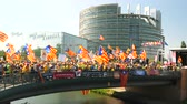 political rally : Strasbourg, France - Jul 2 2019: People on bridge holding Estelada Catalan separatist flags demonstrate protest front of EU European Parliament against exclusion of three Catalan elected MEPs