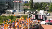political rally : Strasbourg, France - Jul 2 2019: Drone view of Large group of people waving Estelada Catalan separatist flags demonstrate protest front of EU European Parliament against exclusion of three Catalan elected MEPs Stock Footage