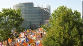 political rally : Strasbourg, France - Jul 2 2019: Aerial view of people holding Estelada Catalan separatist flags demonstrate protest front of EU European Parliament against exclusion of three Catalan elected MEPs Stock Footage