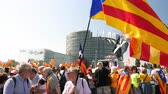 political rally : Strasbourg, France - Jul 2 2019: Seniors people holding Estelada Catalan separatist flags demonstrate protest front of EU European Parliament against exclusion of three Catalan elected MEPs Stock Footage
