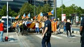 political rally : Strasbourg, France - Jul 2 2019: Time lapse Police guiding People holding Estelada Catalan separatist flags demonstrate protest front of EU European Parliament against exclusion Catalan elected MEPs