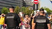 catalão : Strasbourg, France - Jul 2 2019: Gendarmerie Police guiding protesters with Catalan separatist flags demonstrate protest front of EU European Parliament against exclusion of Catalan elected MEPs