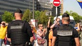 протест : Strasbourg, France - Jul 2 2019: Rear view of two gendarmerie Police guiding protesters with Catalan separatist flags demonstrate protest front of EU European Parliament Стоковые видеозаписи