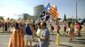 political rally : Strasbourg, France - Jul 2 2019: Side view of people holding placards walking at demonstration protest front of EU European Parliament building against exclusion of Catalan elected MEPs slow motion